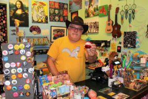 Laeri Nast, who co-owns Play Toys with his wife Annie, loves to joke around at their 49 Bank Street location in New Milford. He's a prankster who enjoys striking up a conversation with a pair of windup teeth. Alicia Sakal/ Republican-American
