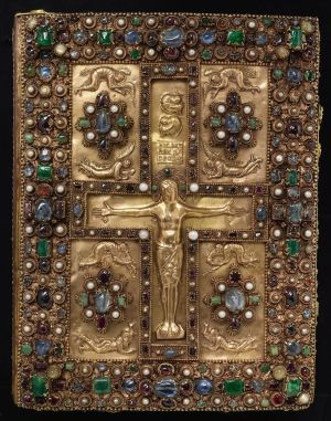 Jeweled Cover of the Lindau Gospels, France, ca. 875. Gold repoussé Crucifixion and ten mourning figures, including personifications of the sun and moon. Workshop of Charles the Bald, grandson of Charlemagne. On: The Lindau Gospels, in Latin Switzerland, Abbey of St. Gall, between 880 and 899. Manuscript on vellum. Purchased by J. Pierpont Morgan, 1901.