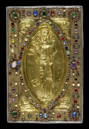 Jeweled cover with silver-gilt repoussé figures of Christ in Majesty and the symbols of the four evangelists, Continental work, last third of the 11th century. On: Gospels of Judith of Flanders, in Latin; Canterbury, England, ca. 1060. Manuscript on vellum. Purchased by J.P. Morgan, 1926.