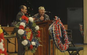 Leo A. Martigneni, chairman of the Torrington Veterans' Support Committee, listens as Isadore