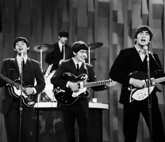 FILE - In this Feb. 9, 1964 file photo, The Beatles, from left, Paul McCartney, Ringo Starr on drums, George Harrison and John Lennon, perform on the CBS