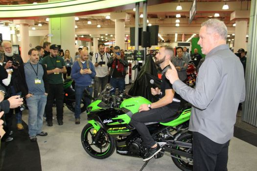 Bud Wilkinson Republican-American Kawasaki senior vice president Bill Jenkins talks to reporters at the Progressive International Motorcycle Show in New York about the 2018 Ninja 400. Seated on the new model is Tom Sykes, who rides for Kawasaki in Superbike World Championship races around the world.