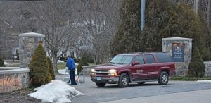 Kent School security blocks the entrance to the independent school Monday afternoon, after school officials canceled classes for the week. Lynn Mellis Worthington Republican-American