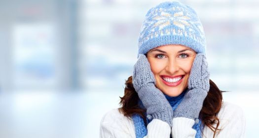 Keeping your skin covered with hats, mittens and scarves is a vital part of protecting your skin from the cold and keeping it healthy. (Fotolia)
