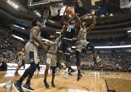 Villanova's Dhamir Cosby-Roundtree (21) is fouled from behind by Connecticut's Tyler Polley as Connecticut's Antwoine Anderson (0) and Terry Larrier (22) defend during the first half of an NCAA college basketball game, Saturday, Jan. 20, 2018, in Hartford, Conn. (AP Photo/Jessica Hill)