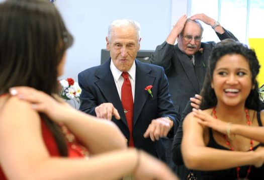 Mickey Capuano of Watertown, center, dances the 'Macarena' with members of the Watertown High School's Interact Club and Student Council in 2011. Republican-American archives