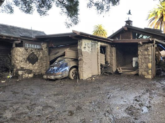 This Jan. 10 photo provided by the Santa Barbara County Fire Department shows damage from mud, boulders and debris that destroyed homes along Montecito Creek near East Valley Road in Montecito, Calif. Associated Press