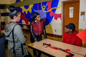 WATERBURY, CT. 10 February 2018-021018BS Erika Cooper of Waterbury speaks about Knowledge is Power celebrating black history month to Andraya Miles and Darrius Burrus at Jonathan Reed School on Saturday. Bill Shettle Republican-American