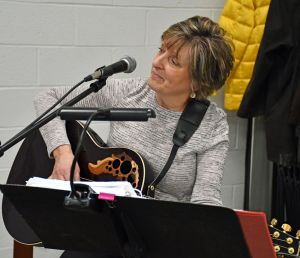 Guitarist and singer Patty Cerruto, a member of the Friends of the Bakerville Library, performed last Saturday during the library's annual Perfect Pair fundraiser. Kathryn Boughton/Republican-American