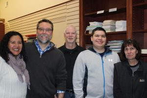 The former owners of the Bank Street Book Nook, Vanessa and David Gronbach (left), stopped in to visit the new owners. Chris Sherrer (middle), and Michael Langit and Terry Sherrer (right), showed them their works in progress. Alicia Sakal/ Republican-American