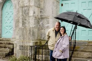 Heather and Stephen Fisher of Torrington, seen here during Wednesday's snowstorm, got married at Center Congregational Church in Torrington during a blizzard nearly 25 years ago. Jim Shannon Republican-American