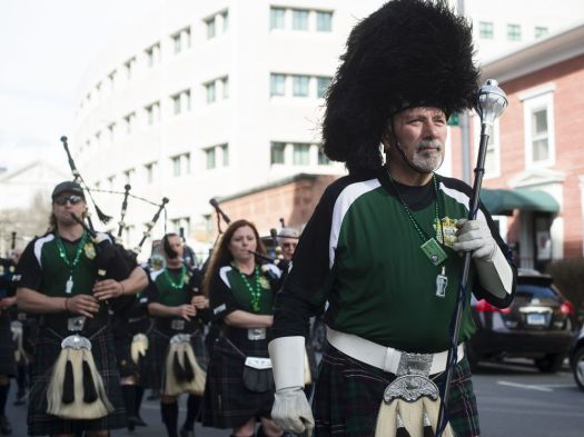 WATERBURY, CT - 17 March 2016-031617EC03-- Bob Roland, the drum major at Police Pipes and Drums of Waterbury, leads the band in a march down Leavenworth Street after performing at Pies & Pints restaurant Thursday. The St. Patrick's Day pub crawl included several performances at area bars and restaurants. Erin Covey Republican-American.