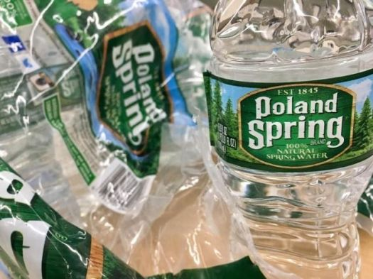 A lawsuit claims that Poland Spring Water is deceiving consumers with evergreen labels that say their bottle contains