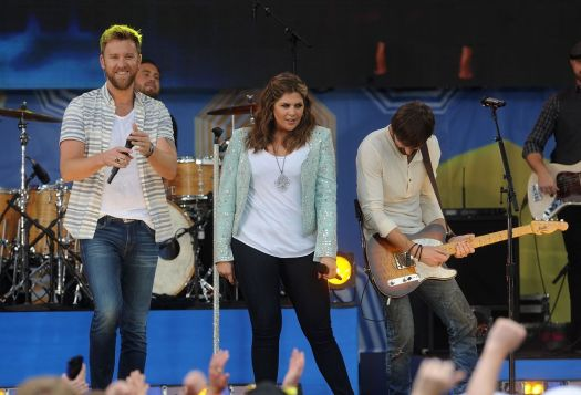 From left, Charles Kelley, Hillary Scott and Dave Haywood of the music group Lady Antebellum perform at Good Morning America at Rumsey Playfield, SummerStage on Friday, May 23, 2014 in New York City, New York. (Photo by Brad Barket/Invision/AP)