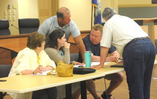 Torrington Democratic Town Committee officer Paul Summers, second from right, listens as fellow officers Sharon Waagner, Danielle Palladino, Chris Cook and Jack Dillon discuss caucus preparations last July. Summers has replaced Palladino as the committee's chairman. Republican-American archive