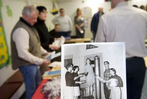 Photos by Jim Shannon Republican-American A photo of Northwestern Connecticut YMCA members that filled a time capsule in 1968 was one of the items removed during the opening of the time capsule Friday in Torrington. One of the students in the photo is Cheryl Kloczko, second from left, both in the photo and in the background.