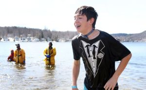 Photos by Steven Valenti Republican-American Fernando Moreno, 14, of Naugatuck, takes the plunge with a group called 'Plymouth Penguins' during the Penguin Plunge fundraiser for Special Olympics Connecticut at Highland Lake in Winsted on Saturday.