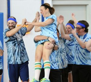 Shannon Gollow of the 'Center School Dodge Ballers' team gets a lift from her brother, Matt McDevitt, as they celebrate a successful moment in the second annual Retro Dodge Ball Tournament in Litchfield on Saturday. John McKenna Republican-American