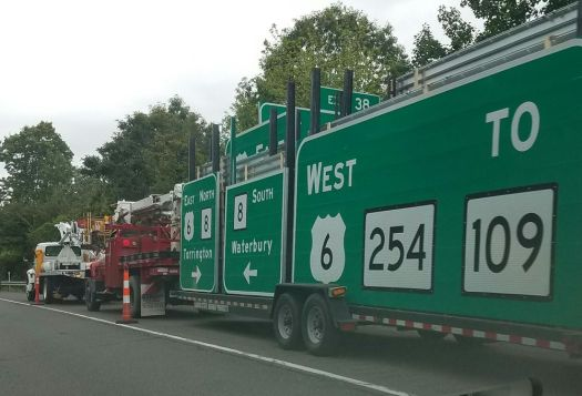 A crew stages equipment on Route 8 southbound in Thomaston as part of a sign replacement project last June. Now the state Department of Transportation is changing speed limit signs on Interstate 84 between Waterbury and Plainville so they all read 65 mph. Andrew Larson / Republican-American