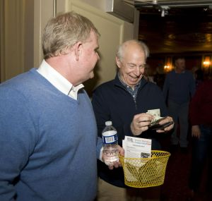 Volunteer Jack Senich, left, collects donations to benefit the Greater Waterbury Campership Fund from Garrett M Moore of Middlebury, Saturday during intermission of Jersey Boys at the Palace Theater in Waterbury. Jim Shannon Republican-American
