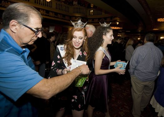 Miss Greater Waterbury Danielle Radeke and Miss Greater Waterbury's Outstanding Teen Lindiana Frangu make their way though the crowd as they collect donations to benefit the Greater Waterbury Campership Fund Saturday during intermission of Jersey Boys at the Palace Theater in Waterbury. Jim Shannon Republican-American
