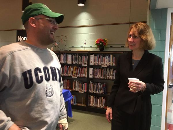Canaan Selectman Craig Whiting chats with incoming North Canaan Elementary School Principal Alicia Roy during a reception held for her on Thursday. She will succeed the retiring Rosemary Keilty on July 1. Ruth Epstein Republican-American