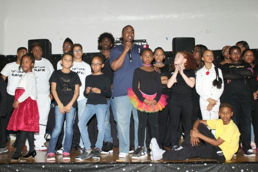Children onstage last year with Zion Baptist Church Youth Minister Rashad Lassiter show off the hair styles they received as part of the church's first Community Hair Show. The second Community Hair Show will be on April 8 with the same goal of promote self-esteem and self-confidence. Contributed photo by Alicia Pittman