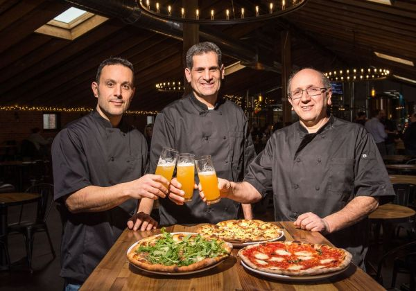 From left Rick Trocchi, Michael Annenberg, and Vin Crudele, the owners of the Restaurant Sauced which is inside of Kinsmen Brewery in Southington pose for a photo on Thursday afternoon. Bill Shettle Republican-American