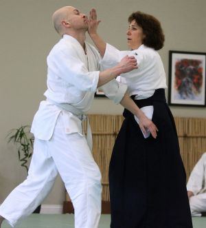 cutline attribution name:PHOTOS BY JOHNMcKenna Republican-American Laura Pavlick of Litchfield Hill Aikikai demonstrates a self-defense technique on one of her students, George Dorosh of New Milford, during a training session.