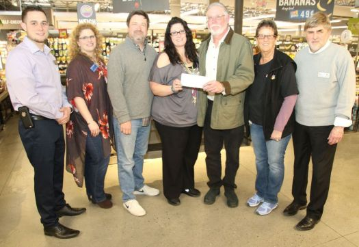 Litchfield-Morris Rotary Club member Bob Kluge, center right, receives a $2,994 check from Sherry Begey, customer service manager at Stop & Shop. With Kluge and Begey are, from left, nonperishable food manager Tony Morone; Mickie Budny and Ron Swanson, both of the Rotary Club; front-end manager Irene Balboni and store manager Joe Sansone.