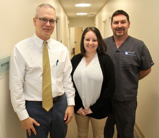 Dr. John Mullen, left, a partner with OrthoConnecticut, receptionist Erin Lafond and radiology technician Michael Rivard stand in the orthopedic medical practice's new office in Litchfield on Friday. John McKenna Republican-American