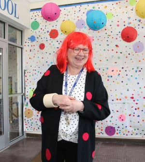 Center School art teacher Rochelle Clementson is a colorful sight during the opening of the school's art show. John McKenna Republican-American