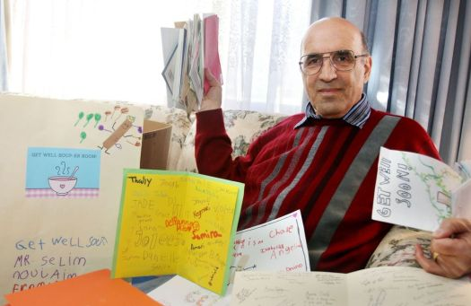 Selim Noujaim rests at home reading the many get-well cards he has received after he was struck by a car last October and seriously injured in this photo from January. Republican-American