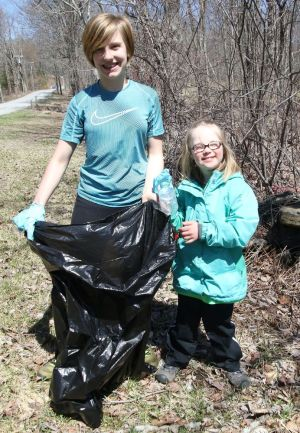 Sisters Julia, 12, and Kaelyn Fischer, 8, of Warren, were among the participants in the town's Earth Day roadside cleanup. John McKenna Republican-American