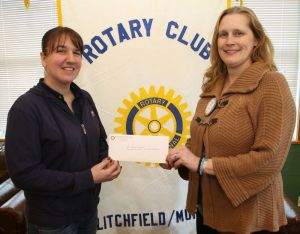 Teresa Spring, right, of Litchfield-Morris Rotary Club, presents a check to Katie LaPointe, chairwoman of the Run for Hope fundraiser. John McKenna Republican-American