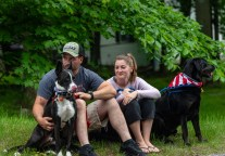 WOLCOTT, CT. 28 May 2018-052818BS352 - Evan Gathier and his wife Marisa, of Wolcott, along with their dogs Jack, left, and Axel get a good spot to watch the 2018 Wolcott Memorial Day Parade on Monday evening. Bill Shettle Republican-American