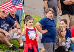 WOLCOTT, CT. 28 May 2018-052818BS352 - Sophia Duran, 5, waving the flag and Antonio Venditti, 9, both of Waterbury get prime spots along the route of the 2018 Wolcott Memorial Day Parade on Monday evening. Bill Shettle Republican-American