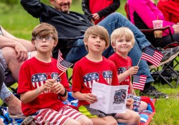 WOLCOTT, CT. 28 May 2018-052818BS352 - Children dressed in patriotic shirts line the streets honoring those lost during the 2018 Wolcott Memorial Day Parade on Monday evening. Bill Shettle Republican-American