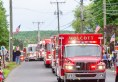 WOLCOTT, CT. 28 May 2018-052818BS352 - Wolcott Volunteer Firefighters and their equipment of Rescue Trucks and Fire Engines drive down the route of the 2018 Wolcott Memorial Day Parade on Monday evening. Bill Shettle Republican-American