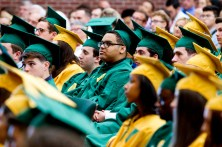 WATERBURY, CT-060218JS03-- Graduating students listen to the commencement address by classmate Caitlin Dreher during graduation ceremonies Sunday at Holy Cross High School. Jim Shannon Republican American
