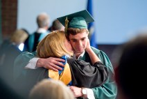 WATERBURY, CT-060218JS08-- Holy Cross graduate Brendan Lynch gets a congratulation hug from his mother Liz Lynch, a foreign language teacher at the school, after receiving his diploma during graduation ceremonies Sunday at Holy Cross High School. Jim Shannon Republican American