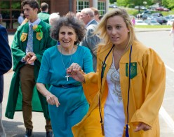 WATERBURY,, CT-060218JS11-- Holy Cross graduate Madelynn Mowad makes her way through celebrating graduates with Sister Pat James following graduation ceremonies Sunday at Holy Cross High School. Jim Shannon Republican American