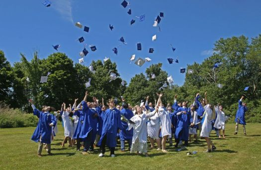 Shepaug Valley School graduates celebrate after commencement on Saturday morning in Washington, Conn. Michael Kabelka / Republican-American