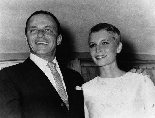 Frank Sinatra and Mia Farrow smiles fondly outside the Sands Hotel suite where they were married on July 19, 1966 in Las Vegas, Nevada. (AP Photo)