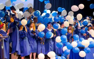 Lewis Mills graduates celebrate as balloons fall at the end of Thursday's ceremony at the Warner Theatre in Torrington. Jim Shannon Republican American