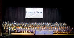Lewis Mills High School's 190 graduates sit on stage Thursday at the Warner Theatre in Torrington.  Jim Shannon Republican American