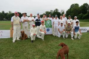 Salisbury Cricket Club and its opponents take a break to pose for a photo during the annual Salisbury cricket match Saturday at Community Field. The Ruth Epstein Republican-American