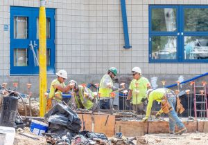 WOODBURY, CT. 07 June 2018-060718BS17 - Concrete is poured into forms as workers from Nosal Builders work on the continuing improvements in the front of Nonnewaug High School on Thursday afternoon. Bill Shettle Republican-American