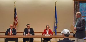 Republican candidates for the 5th Congressional District, from left, Rich DuPont, Manny Santos and Ruby Corby O'Neill are seated at the start of the forum moderated by John Morris, right, Thursday evening at Kent Town Hall. Lynn Mellis Worthington Republican-American