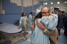 Substitute teacher Bill Bosch greeted graduates before they crossed the stage at Oxford High School on Wednesday, June 20 in Oxford, Conn. Christopher Burns Republican/American